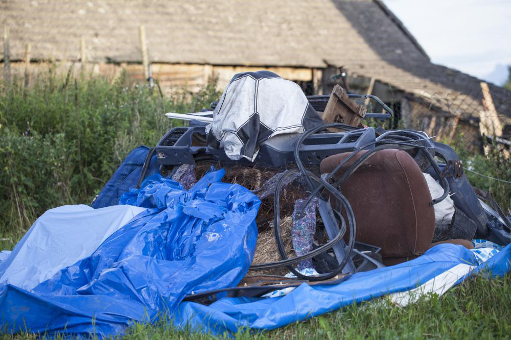 A mountain of junk in a residential backyard