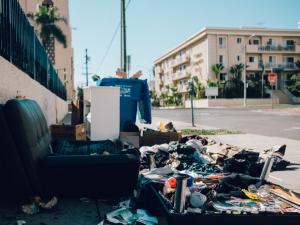 Old furniture, garbage, and scrap waste on the sidewalk