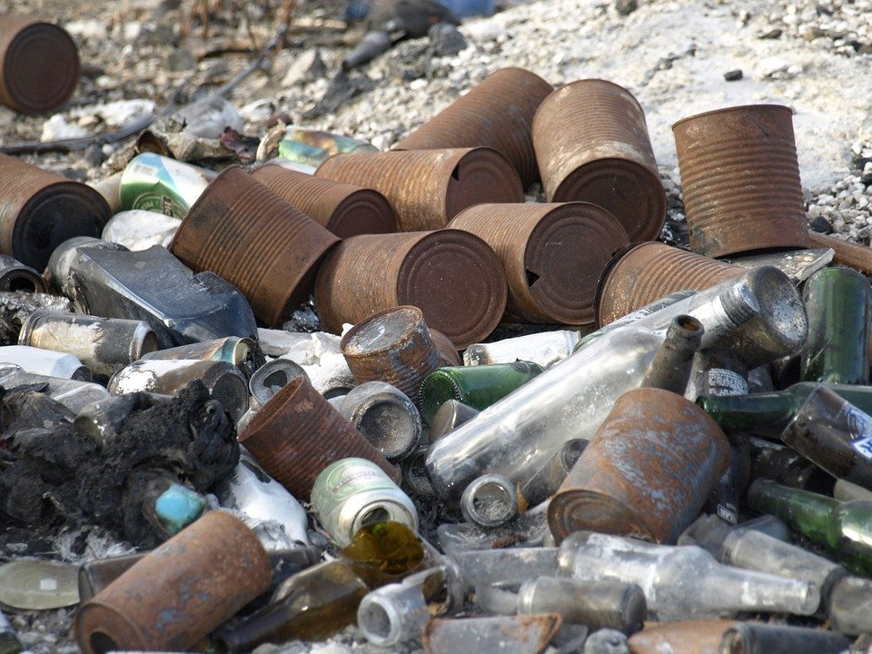 Metal scrap, tins, and garbage in a landfill